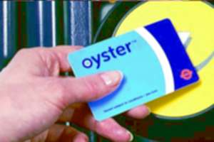 An Oystercard being passed over an Oystercard reader