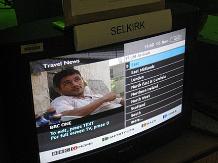 TV with 'Selkirk' sign above it